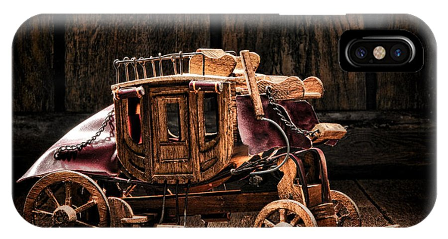 Western IPhone X Case featuring the photograph Toy Stagecoach by Olivier Le Queinec