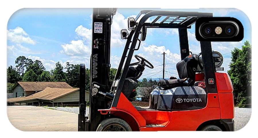 A Toyota Fork Lift With A Nice Sky In The Back Ground. IPhone X Case featuring the photograph Toyota Fork Lift by Robert Loe