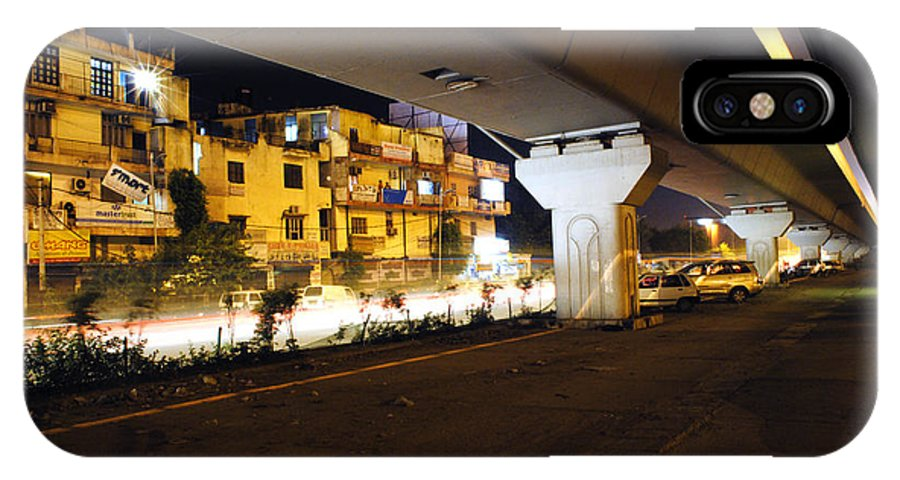 Cars IPhone X Case featuring the photograph Traffic Running Beneath Flyover by Sumit Mehndiratta