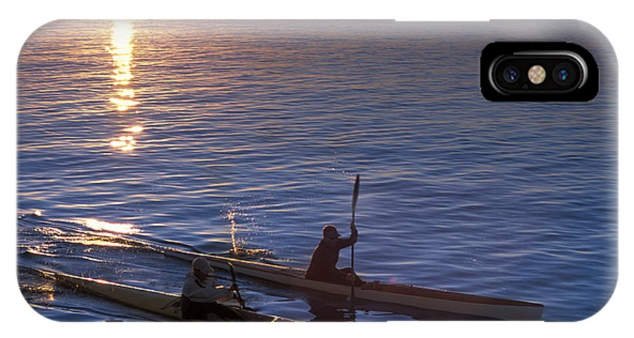 30s IPhone X Case featuring the photograph Two Paddlers In Sea Kayaks At Sunrise by Kevin Steele