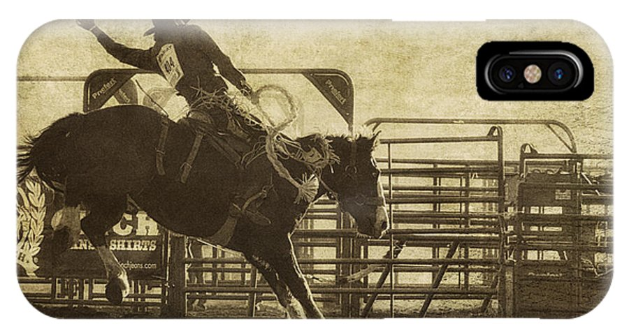 Rodeo IPhone X Case featuring the photograph Vintage Saddle Bronc Riding by Priscilla Burgers