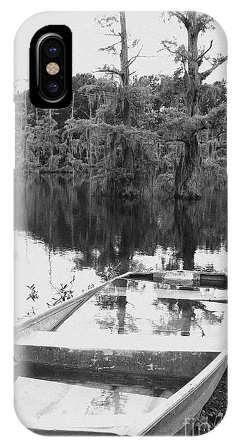 Boat IPhone X Case featuring the photograph Waterlogged by Scott Pellegrin