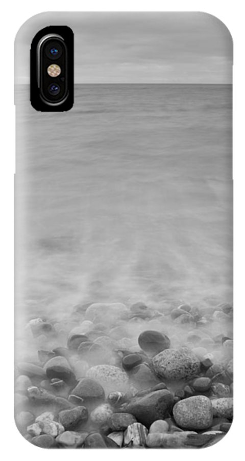 Seascape IPhone X Case featuring the photograph Wet Pebbles by Frank Koenig