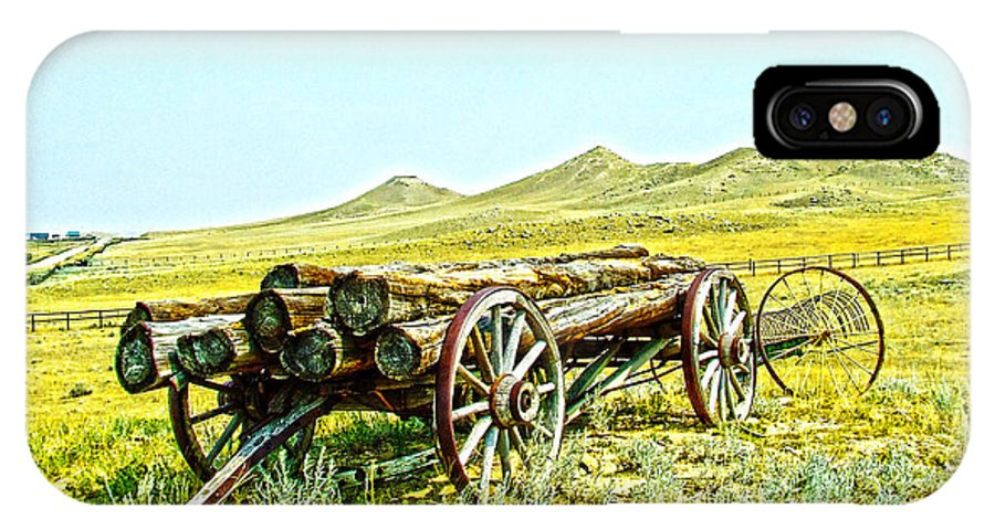Wagons IPhone X Case featuring the photograph Wheels Of Change by Joe Bledsoe