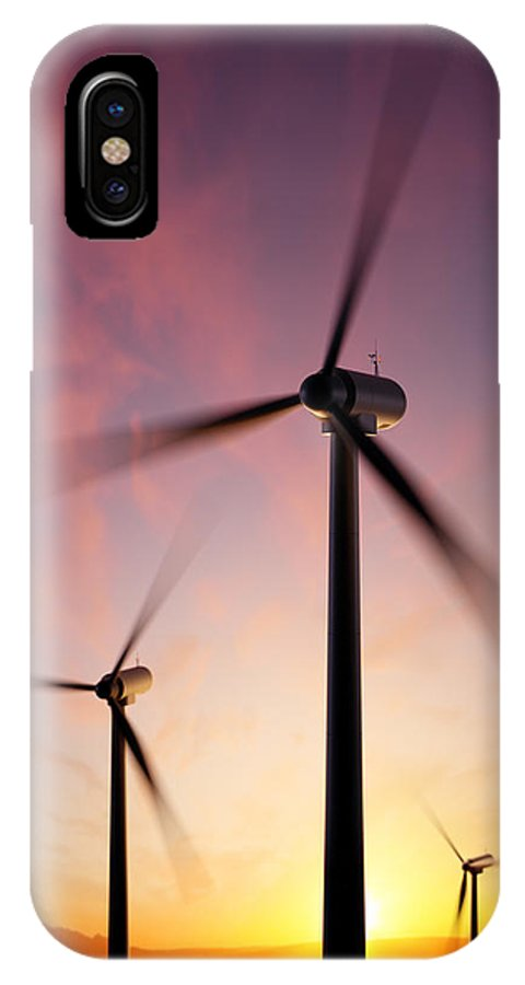 Wind IPhone X Case featuring the photograph Wind Turbine Blades Spinning At Sunset by Johan Swanepoel