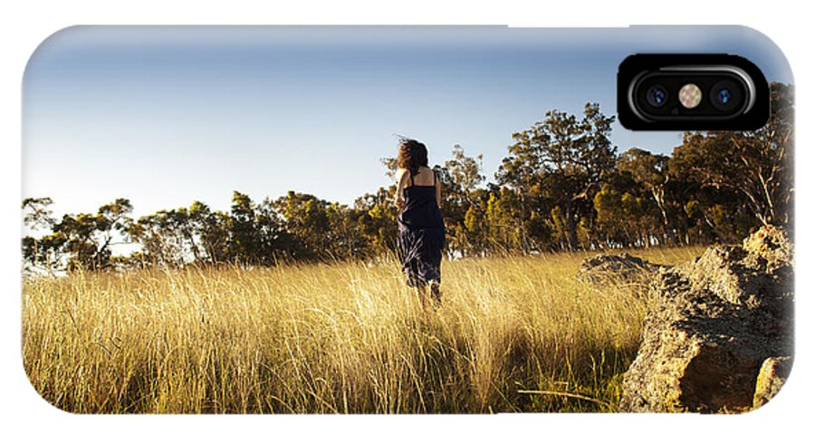 Australia IPhone X Case featuring the photograph Woman Running Through Field by Tim Hester