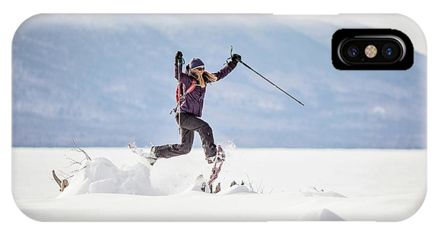 Flagstaff Lake IPhone X Case featuring the photograph Young Woman Jumping While Snowshoeing by Chris Bennett