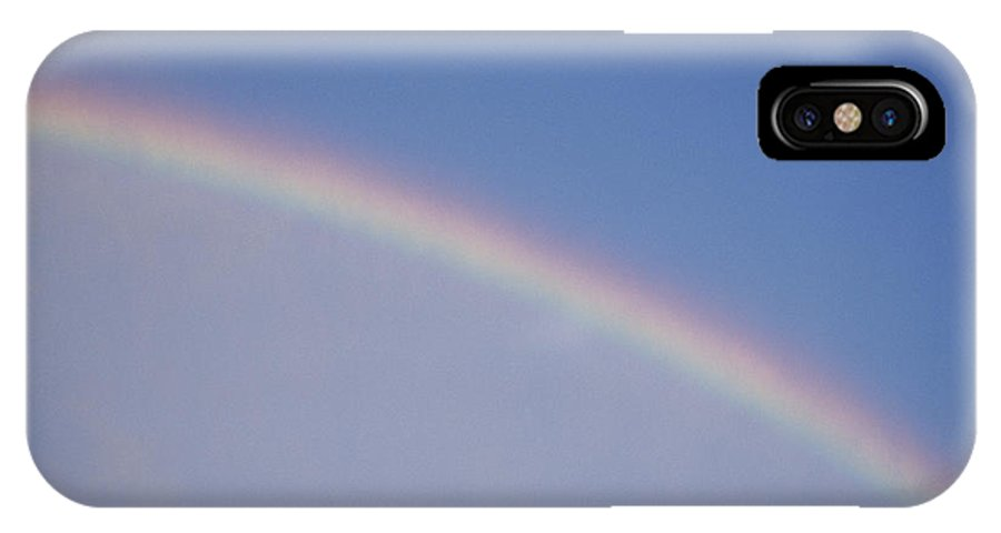 Natural Forces And Phenomena IPhone X / XS Case featuring the photograph A Rainbow Arcs Across The Sky by Joel Sartore
