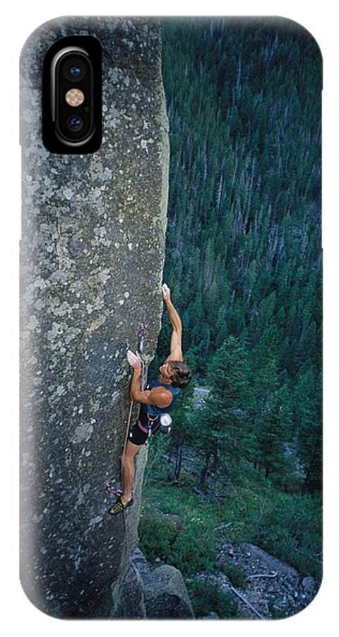 Sporting Goods IPhone X / XS Case featuring the photograph A Rock Climber In Montanas Hyalite by Gordon Wiltsie