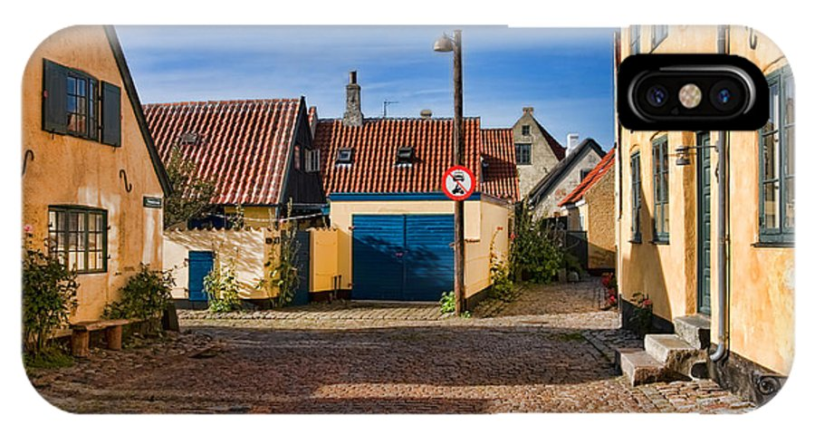 Altstadt IPhone X Case featuring the photograph An Alley In Dragoer by Joerg Lingnau