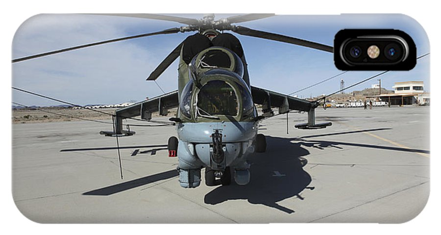 Horizontal IPhone X Case featuring the photograph An Mi-24 Hind Helicopter by Stocktrek Images