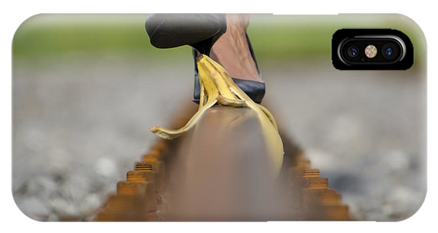 Banana Peel IPhone X Case featuring the photograph Banana Peel On The Railroad Tracks by Mats Silvan