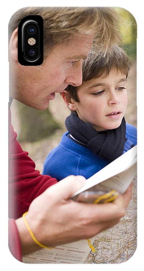 Equipment IPhone X / XS Case featuring the photograph Father And Son Reading A Map by Ian Boddy