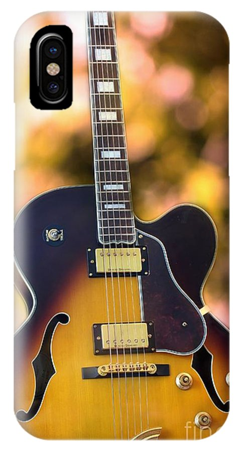 Guitar IPhone X Case featuring the photograph Guitar by Sophie Vigneault