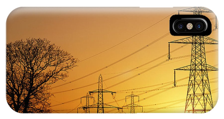 Transmission Line IPhone X / XS Case featuring the photograph Pylons And Power Lines At Sunset by David Parker