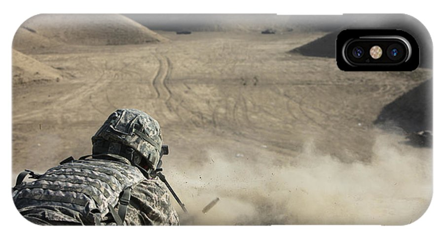 Operation Enduring Freedom IPhone X Case featuring the photograph U.s. Army Soldier Fires A Barrett M82a1 by Terry Moore