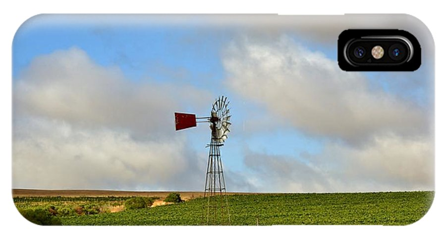 Water Pump; Windmill; Blue; Summer; Warm; Wind; Sky; Grass; Brown; Dry; Westcoast; South Africa; Landscape; Nature; Wine; Field; Grapes; Red; Silver; Background; Decorative; IPhone X / XS Case featuring the photograph Water Pump Windmill by Werner Lehmann
