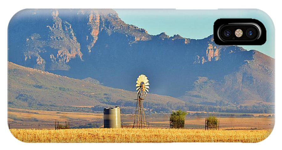 Water Pump; Windmill; Blue; Summer; Warm; Wind; Sky; Grass; Brown; Dry; Westcoast; South Africa; Landscape; Nature; Montains; Background; Decorative; IPhone X Case featuring the photograph Water Pump Windmill by Werner Lehmann