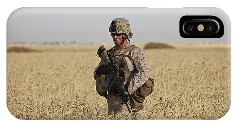 Wheat IPhone X Case featuring the photograph U.s. Marine Patrols A Wadi Near Kunduz by Terry Moore