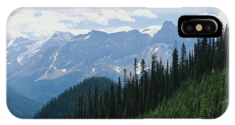 North America IPhone X / XS Case featuring the photograph A Scenic View Of The Rocky Mountains by Michael Melford