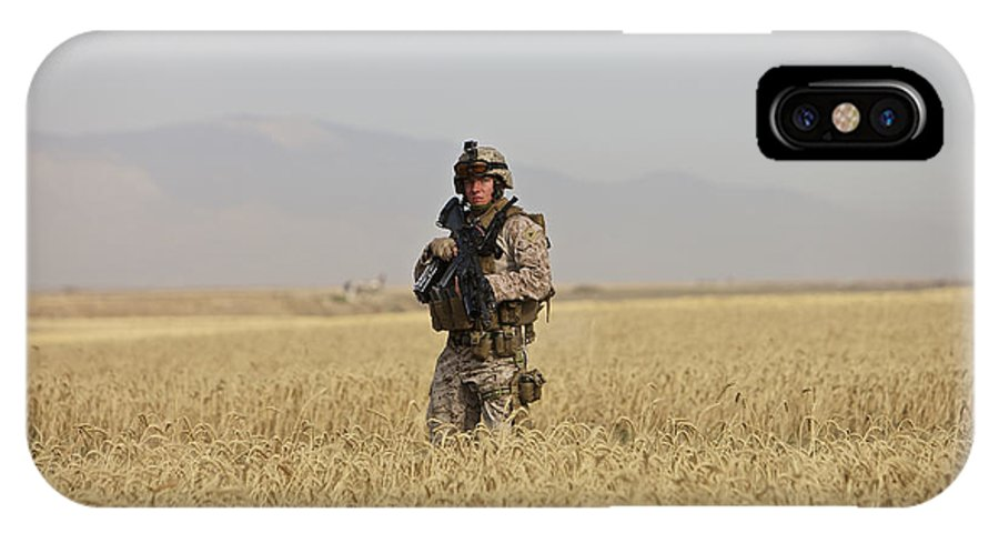 Patrol IPhone X Case featuring the photograph U.s. Marine Patrols A Wadi Near Kunduz by Terry Moore