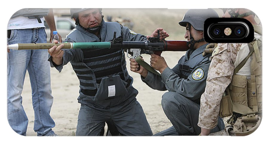 Kunduz IPhone X Case featuring the photograph An Afghan Police Student Loads A Rpg-7 by Terry Moore