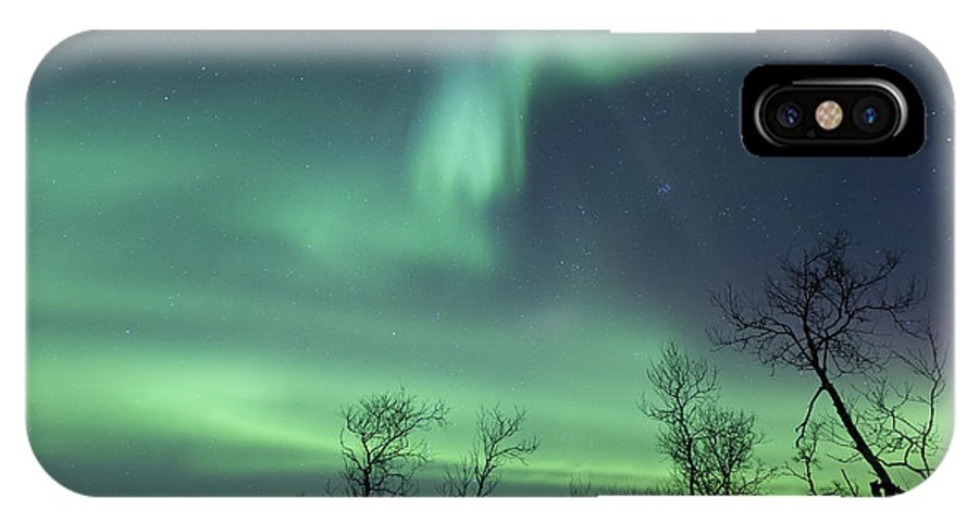 Green IPhone X Case featuring the photograph Northern Lights In The Arctic by Arild Heitmann
