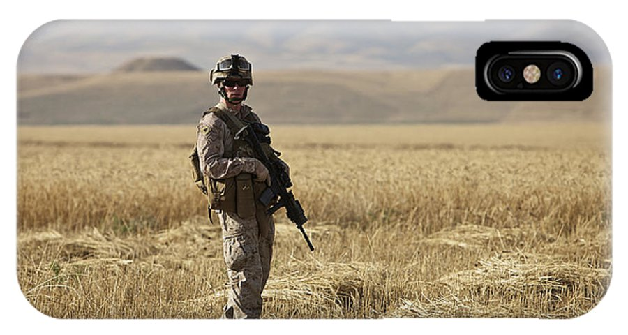 Patrol IPhone X Case featuring the photograph U.s. Marine Patrols A Wadi Near Kunduz by Terry Moore