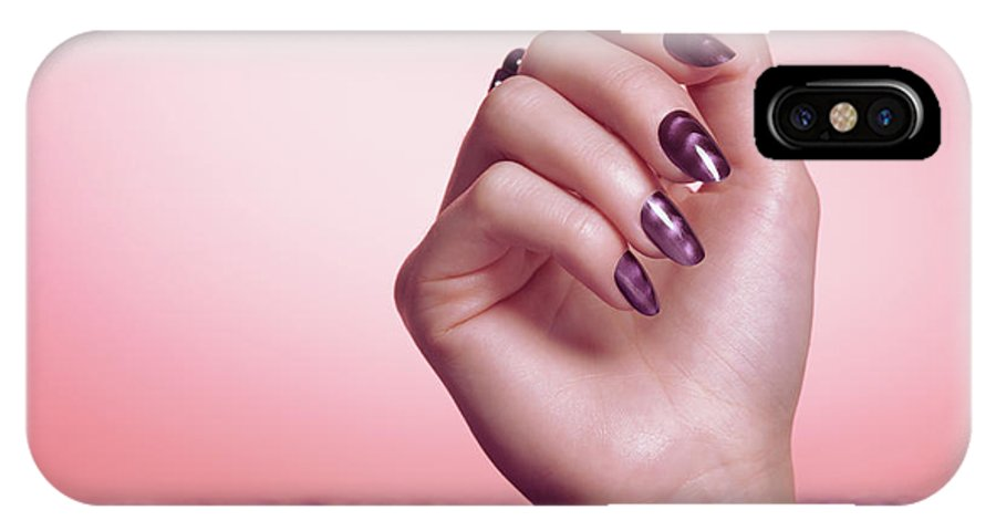 Manicure IPhone X Case featuring the photograph Woman Hand With Purple Nail Polish by Oleksiy Maksymenko