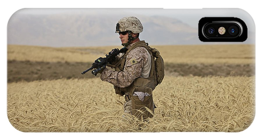 Us Marines IPhone X Case featuring the photograph U.s. Marine Patrols A Wadi Near Kunduz by Terry Moore