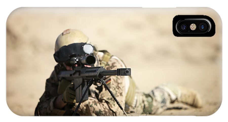 Army IPhone X Case featuring the photograph A German Soldier Sights In A Barrett by Terry Moore