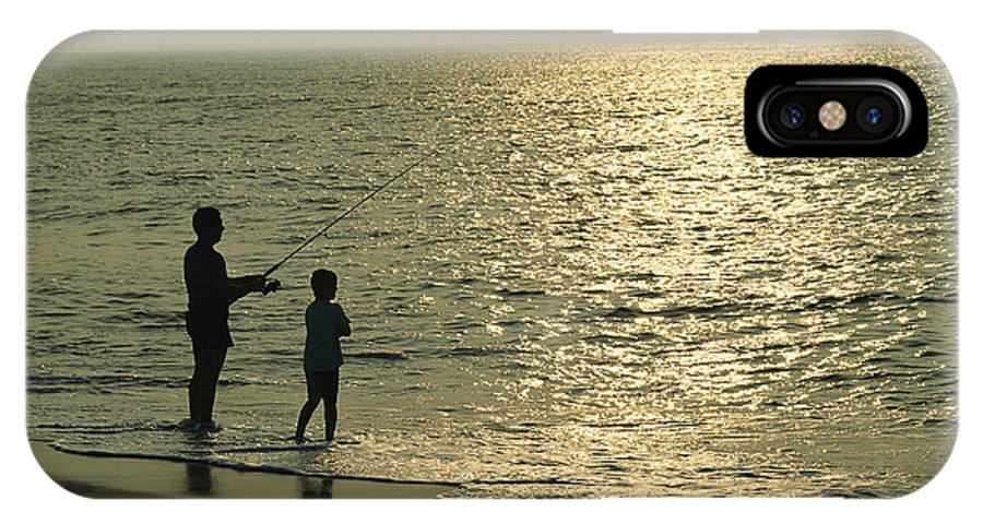 Fishing And Fishermen IPhone X / XS Case featuring the photograph A Man And A Young Boy Fish In The Surf by Medford Taylor