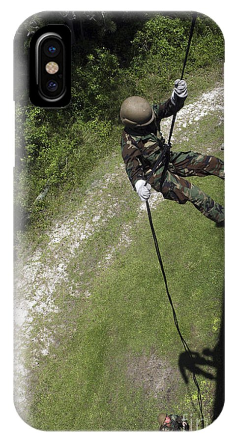 Training Exercise IPhone X Case featuring the photograph A Midshipman Rappels Down A Wall by Stocktrek Images