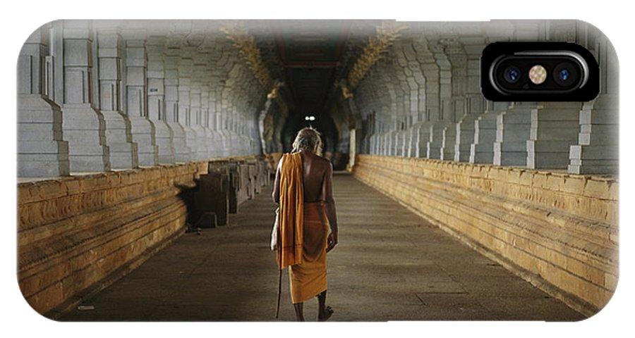 Hindu Clergy IPhone X / XS Case featuring the photograph A Sadu Walks Through Rameswaram Temples by Justin Guariglia