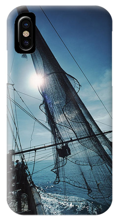 Shrimping IPhone X Case featuring the photograph A Shrimping Boat Off The Coast by Ira Block