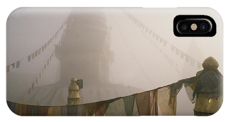 Religion IPhone X / XS Case featuring the photograph A Temple And Prayer Flags Shrouded by David Edwards