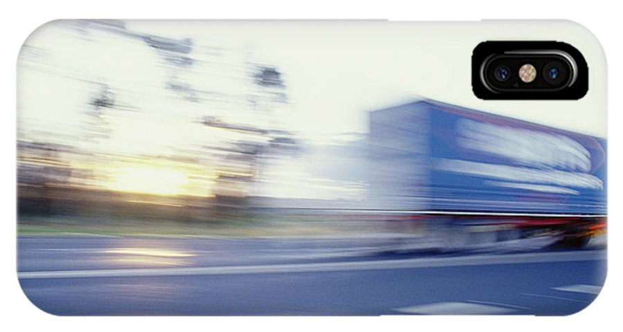 Subject IPhone X / XS Case featuring the photograph A Tractor Trailer Speeding by Jason Edwards
