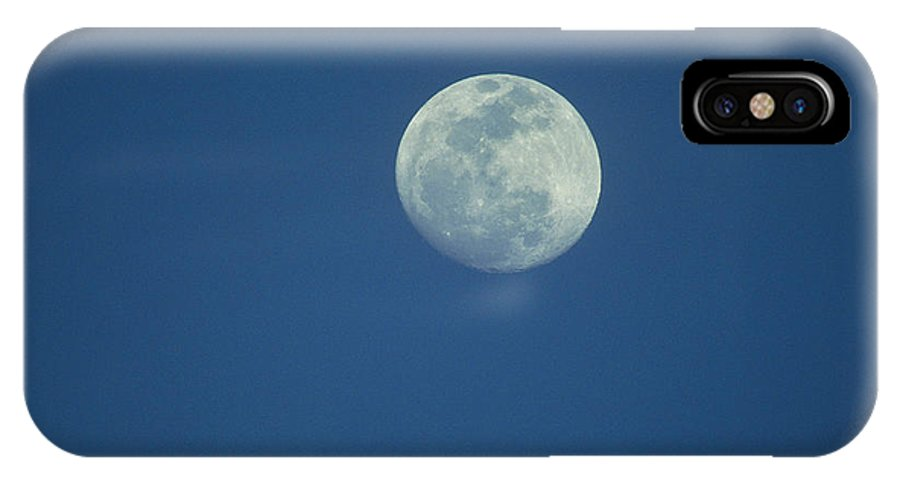 Moons IPhone X / XS Case featuring the photograph A Twilight View Of A Full Moon by Joel Sartore