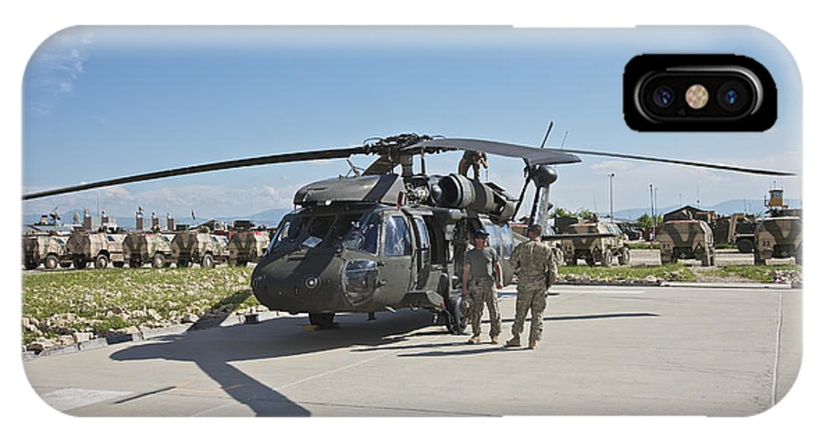 Operation Enduring Freedom IPhone X Case featuring the photograph A Uh-60l Blackhawk Parked On Its Pad by Terry Moore