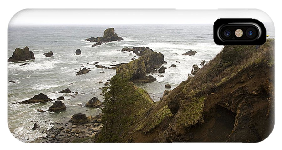 Oregon IPhone X Case featuring the photograph A Young Man Wearing A Yellow Jacket by Michael Hanson