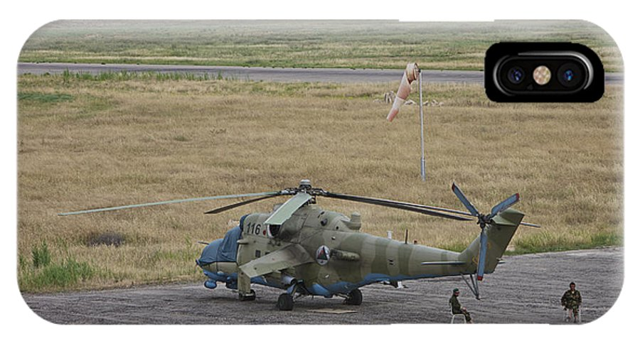 Airport IPhone X Case featuring the photograph Afghan Army Soldiers Guard An Mi-35 by Terry Moore