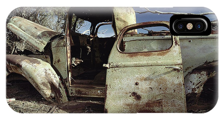 Subject IPhone X / XS Case featuring the photograph An Old Wrecked Truck In A Desert by Jason Edwards