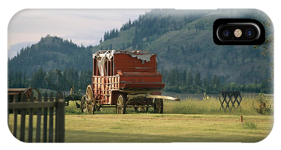 North America IPhone X / XS Case featuring the photograph An Orginal Carriage And Other Equipment by Michael S. Lewis