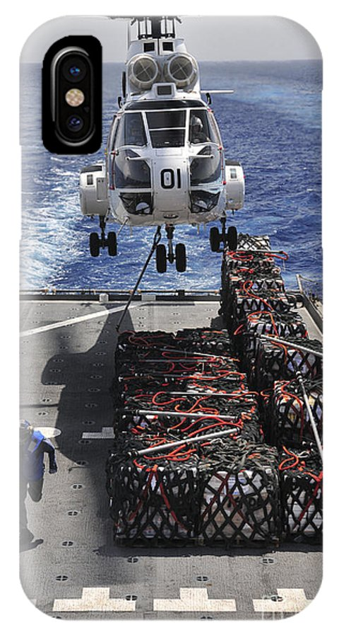 Military Sealift Command IPhone X Case featuring the photograph An Sa-330j Puma Helicopter Picking by Stocktrek Images