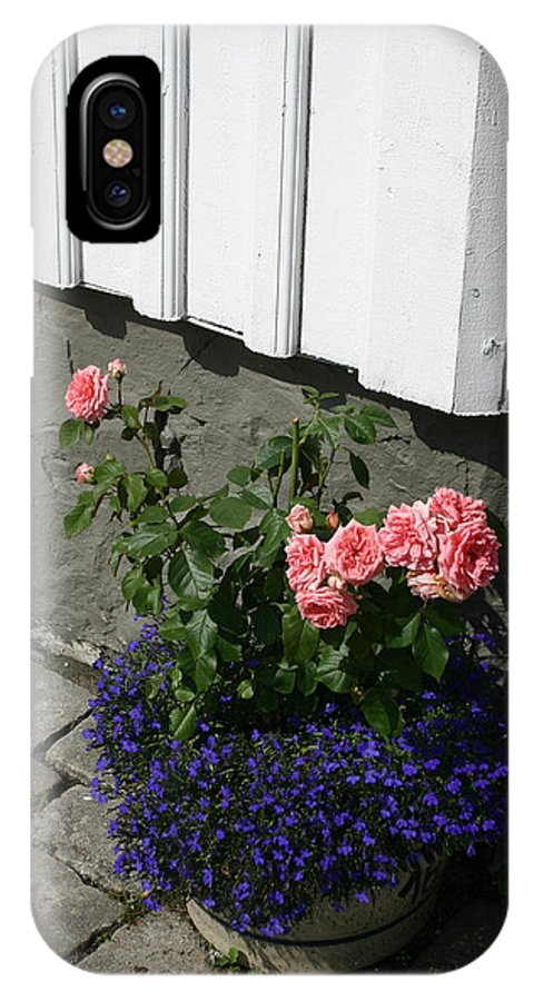 Flowers IPhone X Case featuring the photograph At The Corner Of A House by Nina Fosdick