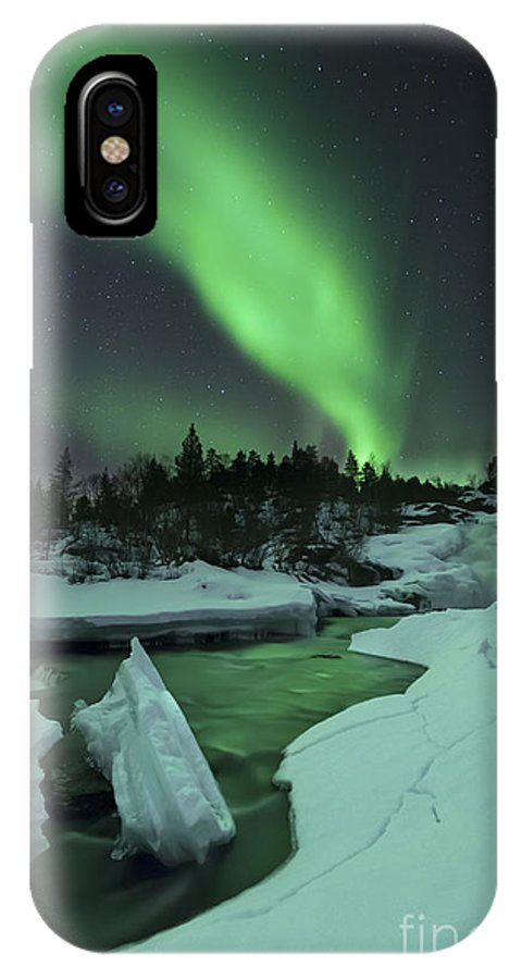 Green IPhone X Case featuring the photograph Aurora Borealis Over A Frozen Tennevik by Arild Heitmann