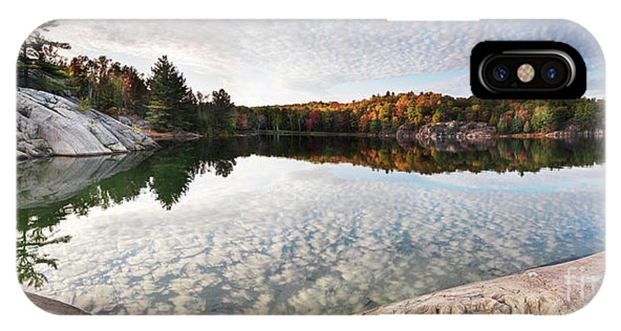 Lake IPhone X / XS Case featuring the photograph Autumn Nature Lake Rocks And Trees Panorama by Oleksiy Maksymenko