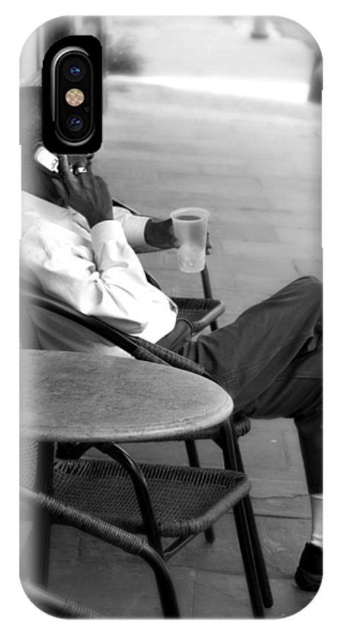 Street Photography IPhone X Case featuring the photograph Black Man Relaxing On Sidewalks Of Asheville by Gray Artus