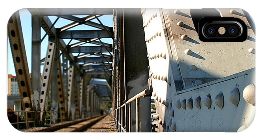 Train IPhone X Case featuring the photograph Bridge by Henrik Lehnerer