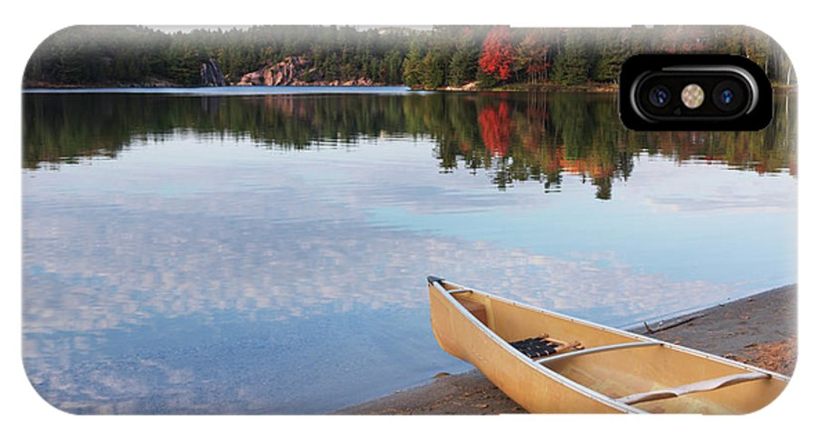 Canoe IPhone X / XS Case featuring the photograph Canoe On A Shore Autumn Nature Scenery by Oleksiy Maksymenko